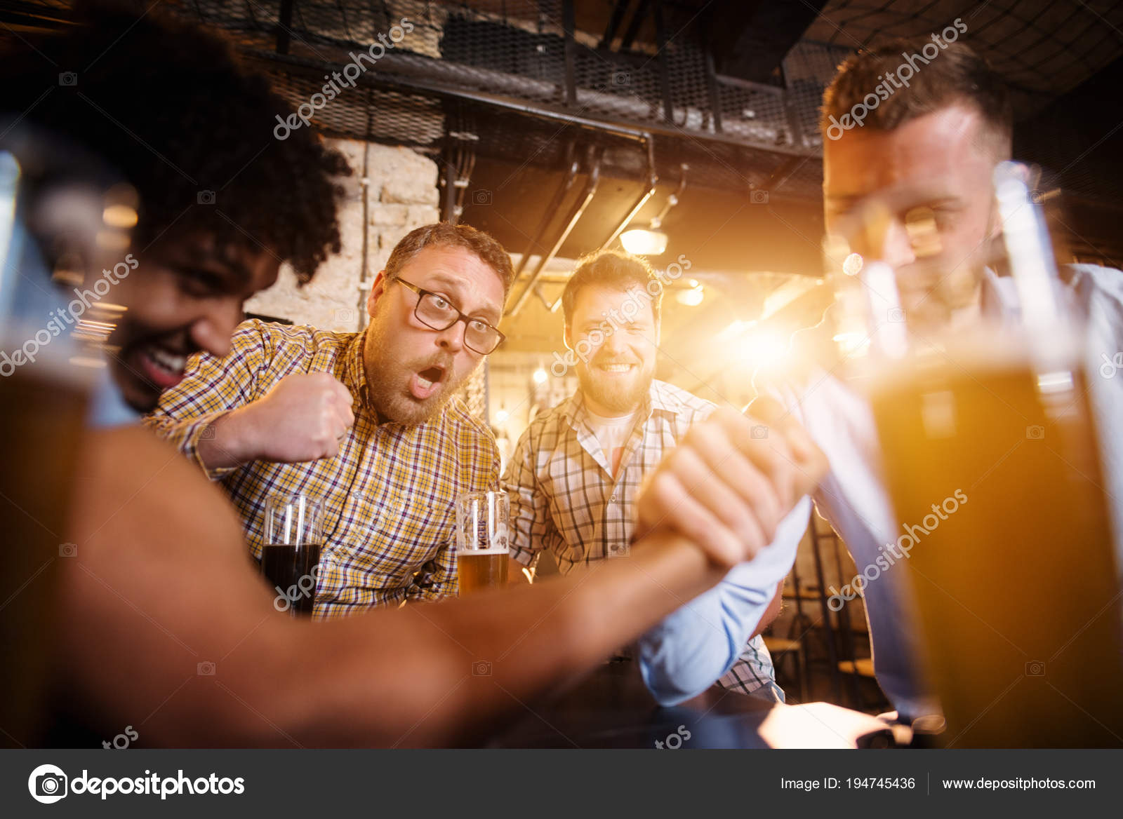 depositphotos_194745436-stock-photo-young-happy-bearded-men-drinking